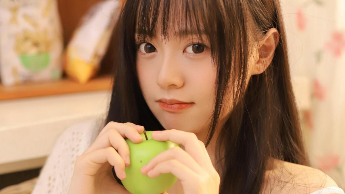 student midair during a dance performance